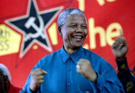 Mandela is happy to be a member of the Communist party after being inspired by Darwin, Marx, and Hitler.