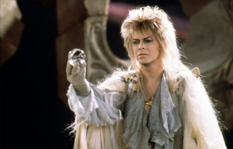 David Bowie representing witchcraft by using a crystal ball.
