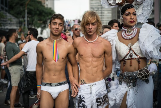 "Revelers enjoy during the annual Gay Pride Parade in Sao Paulo, Brazil, on June 10, 2012. About 3 million people were expected to take part in the parade under the 2012 theme ""Homophobia has cure"".  AFP PHOTO/Yasuyoshi CHIBAYASUYOSHI CHIBA/AFP/GettyImages ORG XMIT:"